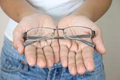 De glazen van de hand stock fotografie