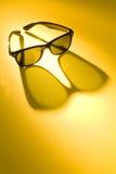De Glazen van de zon op Gele Achtergrond Stock Foto