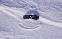 De glazen van de zon op sneeuw Stock Foto's