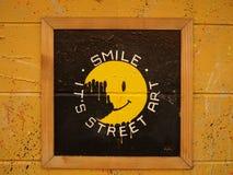 De glimlach, het is Straatart. Stock Afbeeldingen