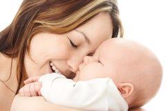 De glimlach van de moeder aan haar kind Stock Afbeelding