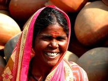 De Glimlach van de vrouw Stock Foto's