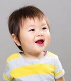 De glimlach van het babymeisje stock foto
