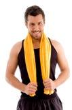 De glimlachende handdoek van de jonge mensenholding Stock Afbeelding