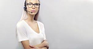 De glimlachende klantendienst of steun representatief met hoofdtelefoon Stock Foto