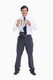 De glimlachende kop van de kleinhandelaarsholding Stock Foto