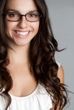 De glimlachende Vrouw van Glazen Royalty-vrije Stock Afbeeldingen