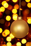 De gloeiende Gouden Lichten van het Ornament en van de Vakantie van Kerstmis Stock Afbeeldingen