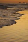 De golf bereikt definitieve Rustende Plaats Stock Afbeeldingen