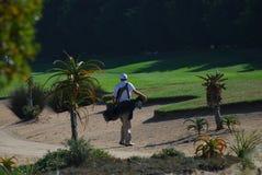 De golfspeler van de bunker Stock Foto's