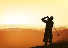 De golfspeler van de zonsondergang Royalty-vrije Stock Afbeeldingen