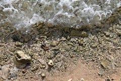 De Golven die van Aruba op Achtergrond komen Stock Afbeeldingen