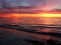 De Golven van de zonsondergang Stock Foto
