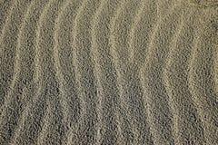 De golven van het zand Stock Foto