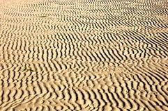 De golven van het zand Stock Foto's