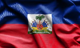 De golvende vlag van Haïti stock fotografie