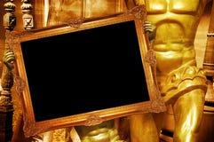 De gouden aankondiging van kader mannelijke standbeelden Royalty-vrije Stock Foto's