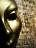 De gouden achtergrond van de maskermuziek Stock Foto's