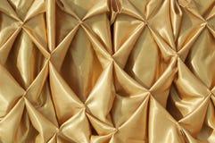 De gouden achtergrond van de stoffentextuur Stock Fotografie