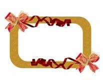 De gouden achtergrond van het boog rode lint Royalty-vrije Stock Fotografie