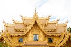 De gouden bouw, Chiangrai, Thailand. Stock Foto