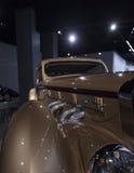 De gouden Coupé Aerosport van Delage D8-120 van 1937 Royalty-vrije Stock Foto's