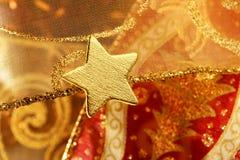De gouden decoratie van Kerstmis met gouden ster Royalty-vrije Stock Afbeelding