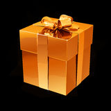 De gouden doos met een gift bond met een gouden lint met een boog op een zwarte achtergrond Royalty-vrije Stock Afbeeldingen