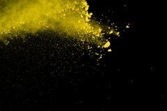 De gouden explosie van poederdeeltjes Schitter uitbarsting met gouden textu stock afbeelding