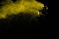 De gouden explosie van poederdeeltjes Schitter uitbarsting met gouden textu stock foto's
