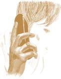 De gouden hand houdt de telefoon Stock Foto