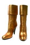 De gouden laarzen van de leer hoge hiel stock afbeeldingen