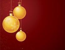 De gouden ornamenten van Kerstmis op rood Stock Afbeelding