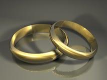 De gouden ringen van het huwelijk Stock Foto's