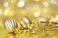 De gouden scène van Kerstmis Royalty-vrije Stock Afbeeldingen