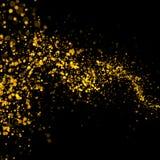 De gouden schitterende bokeh staart van het sterrenstof Stock Foto's