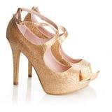 De gouden schoenen van dames Stock Foto's