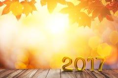 De gouden Tekst van 2017 op oud hout op rode esdoorn op de herfst en bokeh lichte achtergrond Royalty-vrije Stock Foto