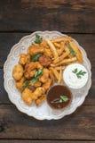 De goudklompjes en de frieten van de kip Royalty-vrije Stock Afbeelding
