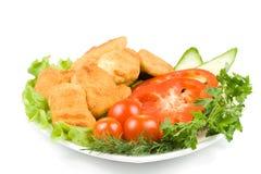 De goudklompjes van de kip met groenten Royalty-vrije Stock Foto's