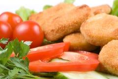 De goudklompjes van de kip met groenten Royalty-vrije Stock Afbeelding