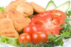 De goudklompjes van de kip met groenten Royalty-vrije Stock Foto