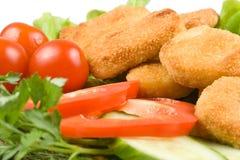 De goudklompjes van de kip met groenten Stock Afbeelding