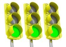 De gröna trafikljusen Arkivfoto