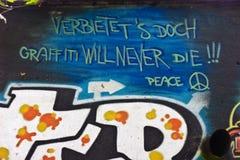 De graffiti zal nooit - Vrede sterven Royalty-vrije Stock Afbeelding