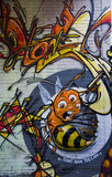 De graffitibij met niet - verbod-de-kan slogan Stock Fotografie
