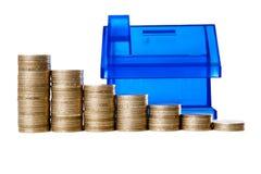 De grafiek en het spaarvarken van het geld Stock Foto