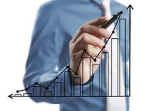 De grafiek van de zakenmantekening het groeien grafiek Stock Fotografie