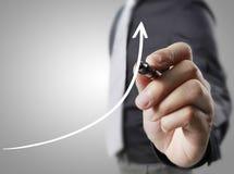 De grafiek van de zakenmantekening het groeien grafiek Stock Foto's
