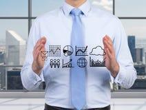 De grafieken van de zakenmanholding Stock Afbeelding